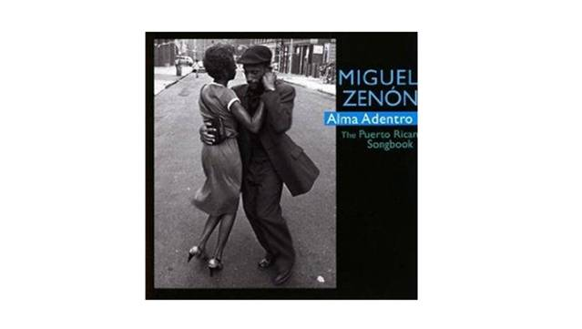 "Grammy nominated sax player Miguel Zenon cover of ""Alma Adentro; the Puerto Rican Songbook"" has a couple dancing in the street."