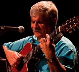 Dori Caymmi playing guitar