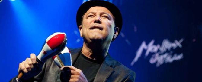 Panamanian Latin music star Ruben Blades playing maracas