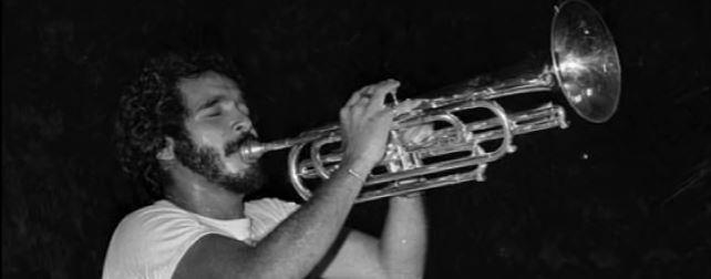 Salsa icon Willie Colon playing trombone