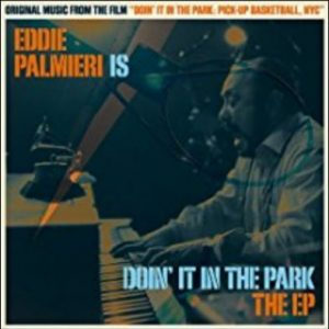 "Eddie Palmieri at piano in ""Doin' it in the Park"" cover art"