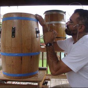 Puerto Rican artisan making barril de Bomba.
