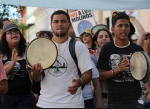 Protesters with Panderos de Plena, not Bomba.